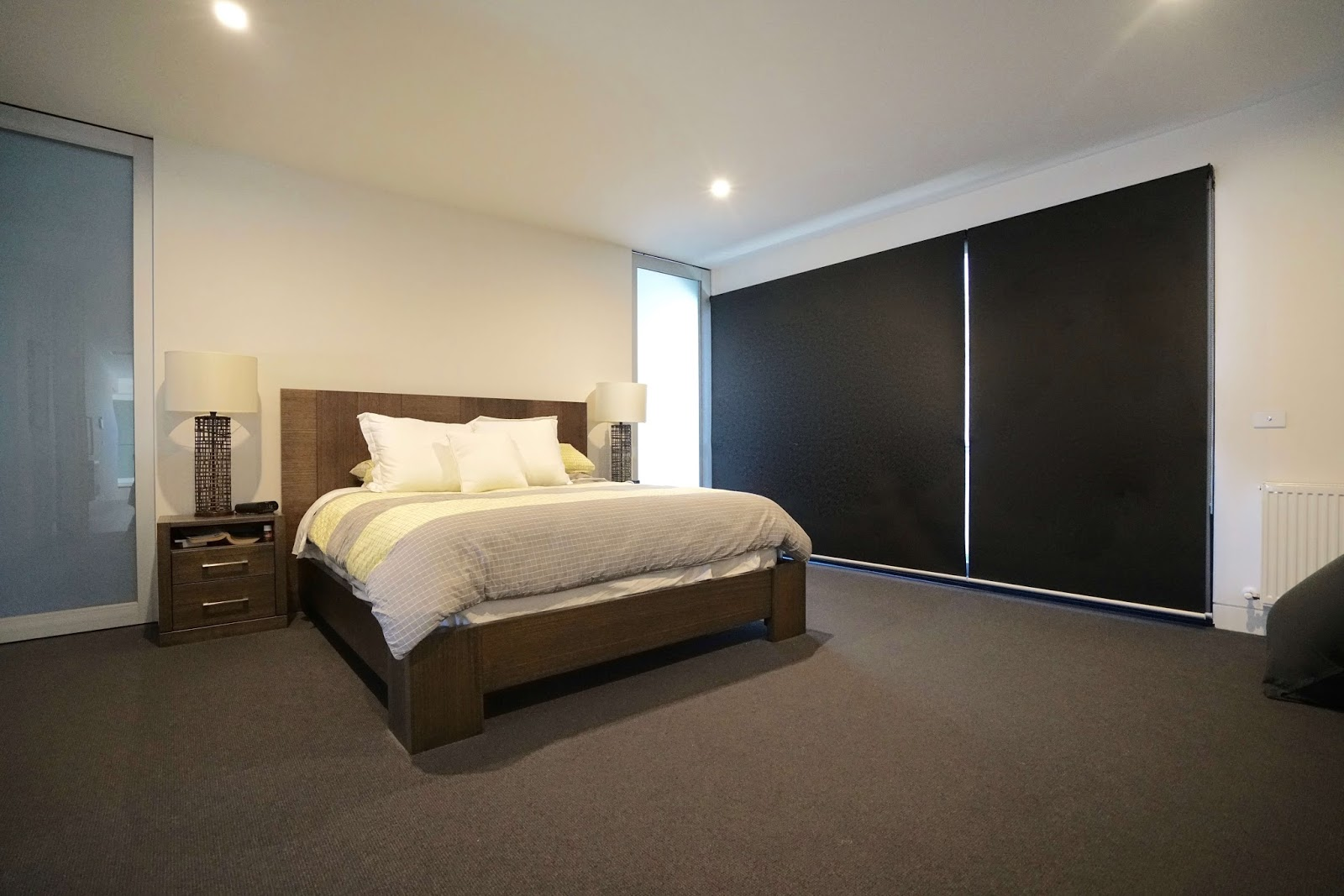 Bedroom with Black Roller Blinds