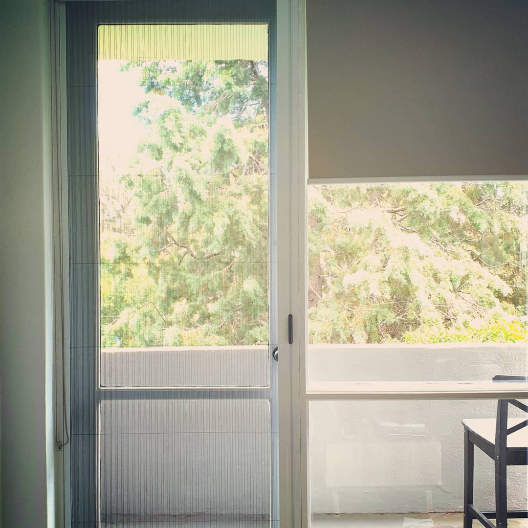 White Door with Blinds