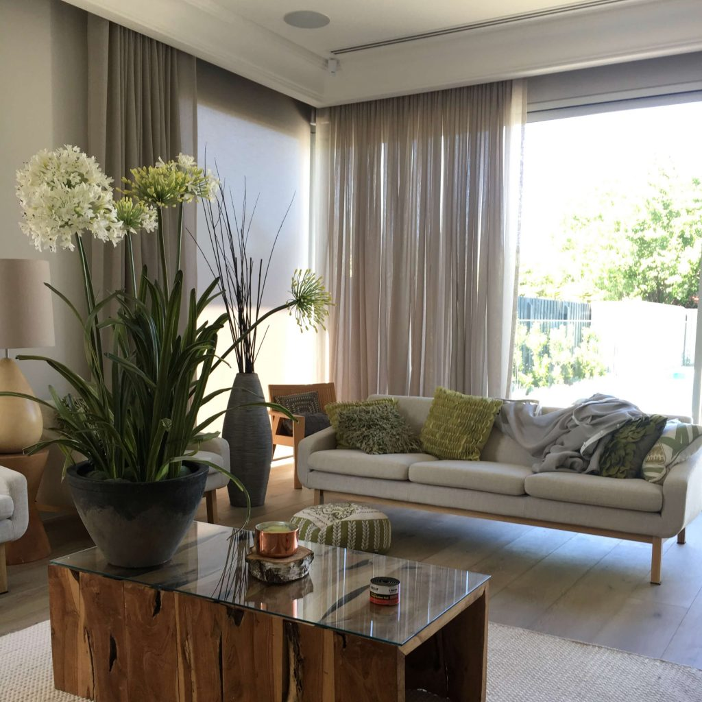 Allusion fabric sheer curtain hanging in a contemporary lounge room