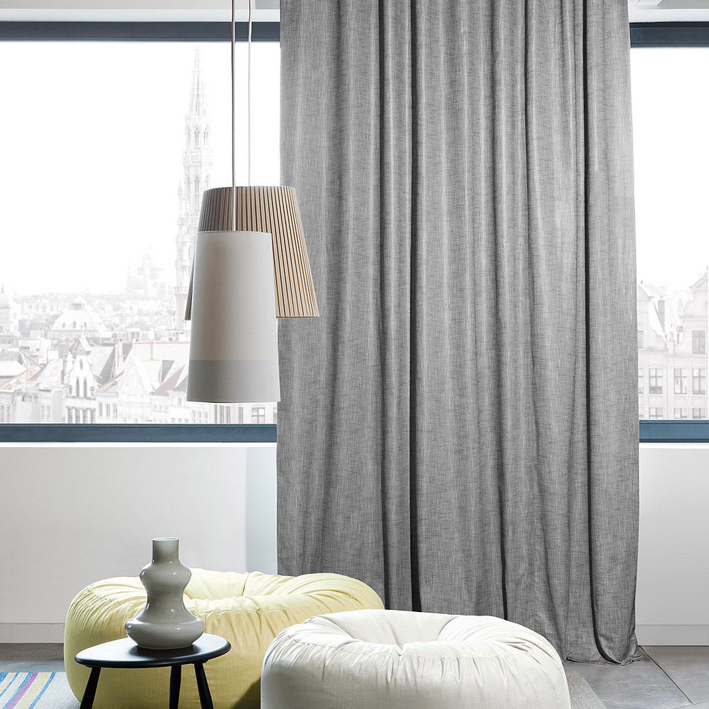 Silver Zepel Magnet Curtains hanging on an modern appartment window.